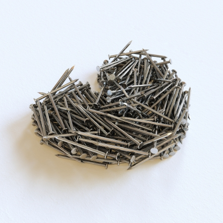 scrap metal: Heart Made from Metal Nails on a White Background