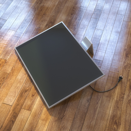 tft: Modern Tv Screen On The Laminate Floor Stock Photo