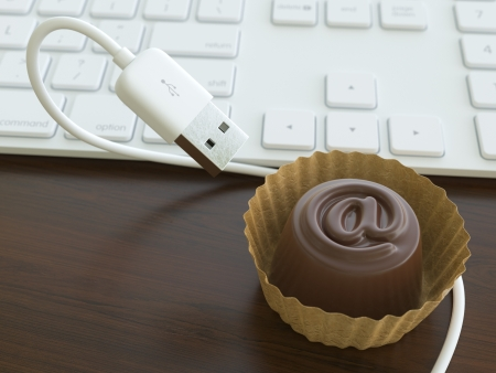 business metaphore: Candy With USB Cable  Conceptual Office Realistic Picture  first version Stock Photo