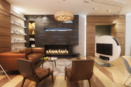 Living Room With Leather Sofa And Armchair Near The Fireplace Standard-Bild