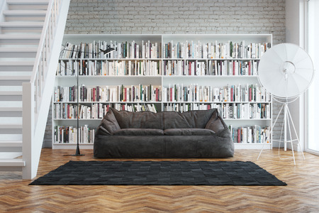 living wisdom: Interior of town house with books arranged in library Stock Photo