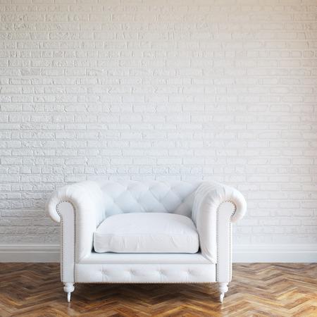 白い壁の古典的な革張りのアームチェアとれんが造りのインテリア