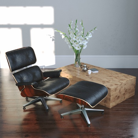 center table: Leather armchair with ottoman and flowers in empty interior Stock Photo