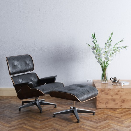 Leather armchair with ottoman and flowers in empty interior photo