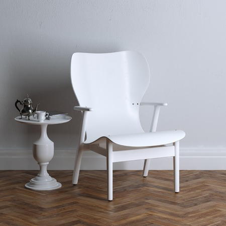 White wooden furniture - armchair and small coffee table photo