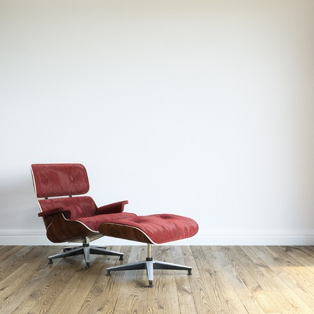 view of an elegant red couch: Modern Red Velvet Armchair With Ottoman In White Wall Interior Stock Photo
