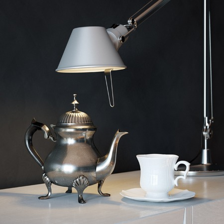 Vintage Metal Coffee Pot With Cup And Lamp On The Coffee Table photo