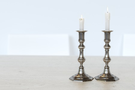 Retro Candelabra With Burning Candles On The Kitchen Table