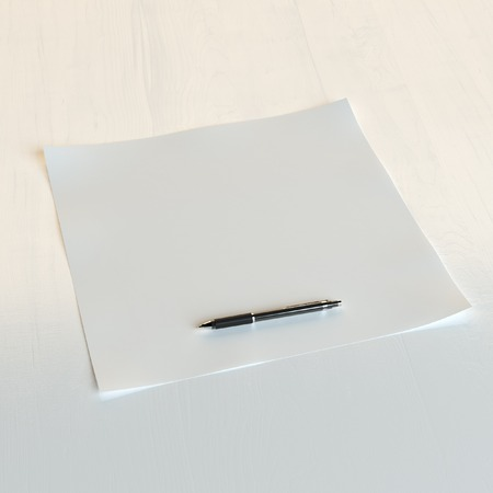 pen and paper: Paper with pen on white (conceptual lifestyle picture)