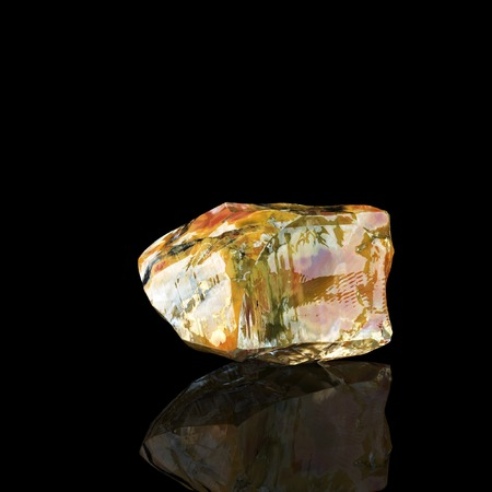 waxy: Shiny Amber Stone On Black Background Third Version Stock Photo