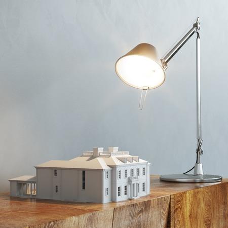 lamp light: 3d model of building under the desk lamp light on wooden table