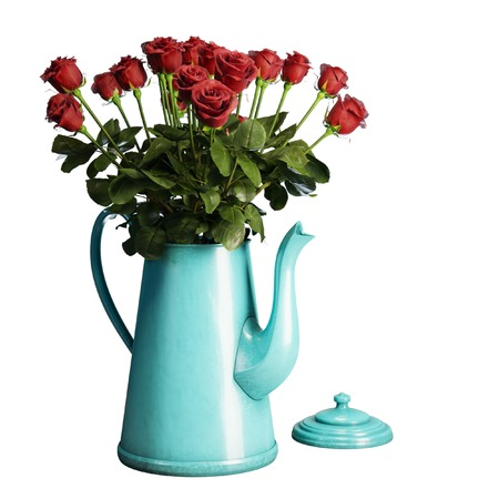 Red roses in blue coffee pot isolated on white background photo