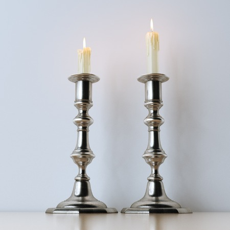 candelabra: Retro candelabra with burning candles on wooden surface
