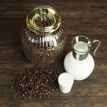 Jug full of milk and jar with coffee beans on wooden surface photo