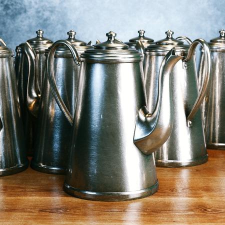 kettles: Number of vintage kettles on wooden surface