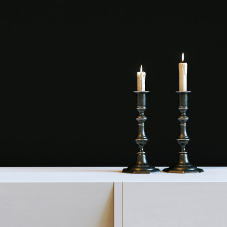 Vintage iron candlestick with burning candles in black interior. 3d render Stock Photo
