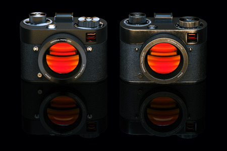 old style retro: Old and new retro style digital camera isolated on black background. 3d render Stock Photo