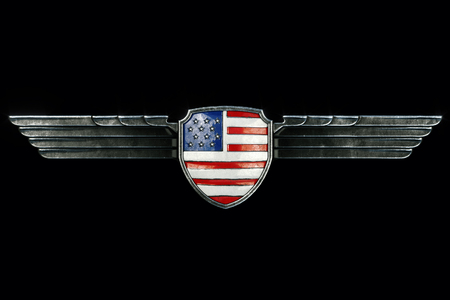 metal frame: USA flag in metal wings frame isolated on black background. Front view. 3d render