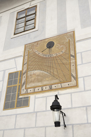 show time: sundial on the white wall of the house a cloudy day did not show time Stock Photo