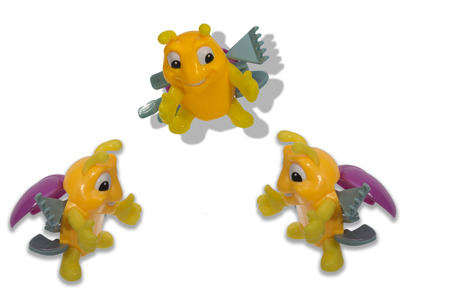 hugs: three amicable toy bee close to each other hugs