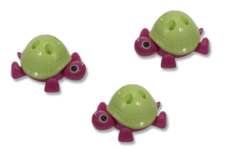 creep: three toy turtle with a green shell creep towards each other