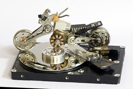 electronics parts: motorcycle model of the parts of the broken hard drive and other electronics