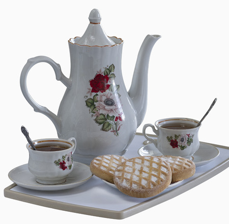 biscuits: a tray with two cups of tea and tea biscuits