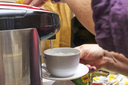 pour the tea into a white cup and saucer, pour a stream of hot water from the thermos