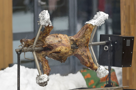 Automatic skewer with strung mutton carcass