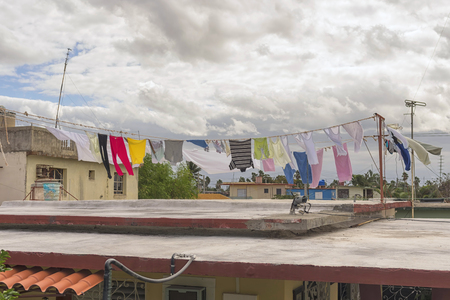 Refugees dry their laundry on the roof of the house Stock Photo