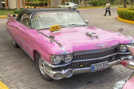 VARADERO, CUBA - JANUARY 05, 2018: Classic pink Cadillac retro car