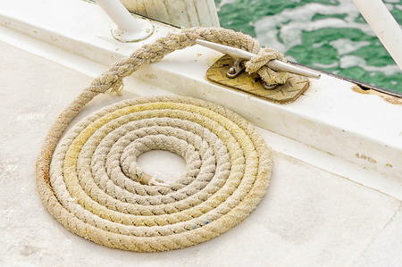 The rope rope is neatly folded on the ships deck Stock Photo