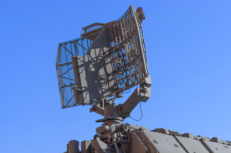 Fragment of air defense radar station against the blue sky