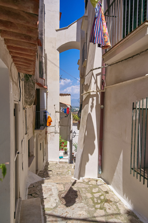 densely standing houses on the narrow street of the old European city