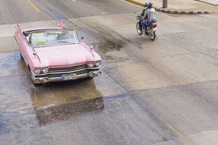 VARADERO, CUBA - JANUARY 05, 2018: Classic pink Cadillac retro car rides on the road of Varadero in Cuba