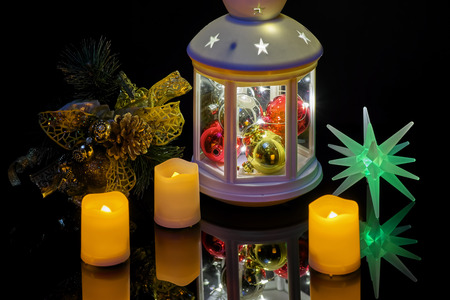 Christmas still life with a flashlight candles and a spruce branch Banque d'images