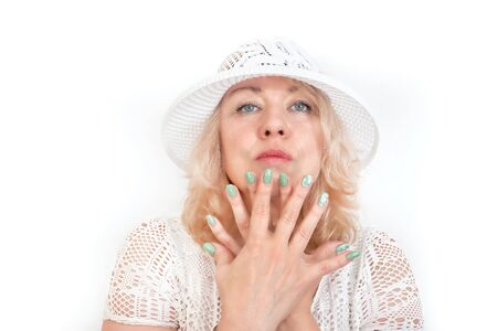 Middle-aged blonde with blue eyes in white clothes, isolate on a white background. Hands with manicure are deployed to the camera 写真素材 - 129785270