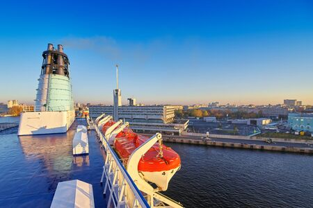 Cruise liner enters the port of St. Petersburg, view from the upper deck at the railway station in the rays of the morning sun