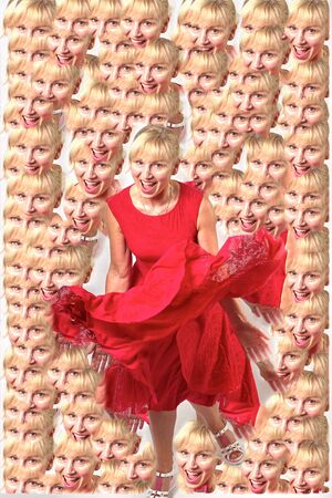 Pretty blonde fifty years old in a red dress dancing and smiling at the camera, isolated full length portrait Foto de archivo - 133384162