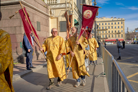 ST. PETERSBURG, RUSSIA - September 12, 2019: Preparing for a religious procession, believers with Orthodox relics gather on Nevsky Prospekt in St. Petersburg