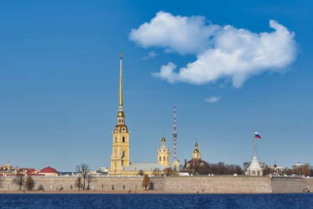 Peter and Paul Fortress on the Neva River. Russia, Saint Petersburg cityscape against the blue sky
