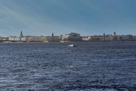 Exchange Embankment of the Neva River and Rastral Columns. Russia, Saint Petersburg cityscape against the blue sky Reklamní fotografie