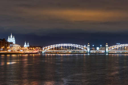Smolny Cathedral and Peter the Great Bridge over the Neva River. Russia, Saint Petersburg, night city landscape Reklamní fotografie