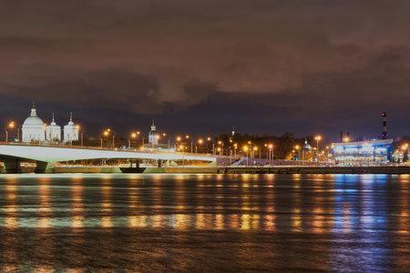 Alexander Nevsky Bridge across the Neva and Lavra rivers. Russia, Saint Petersburg, night city landscape Reklamní fotografie