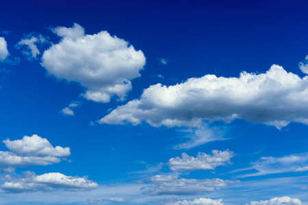 White cumulus clouds on blue sky background, natural phenomenon