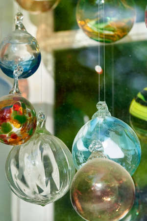 Multicolored glass balls in the window of a glass blowing workshop