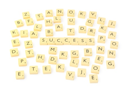 Scrabble letters  with success word  photo