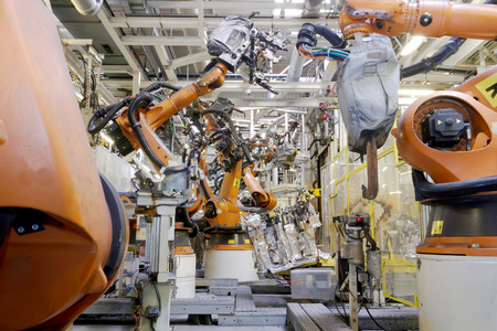 weld: Welding robots in car production Stock Photo