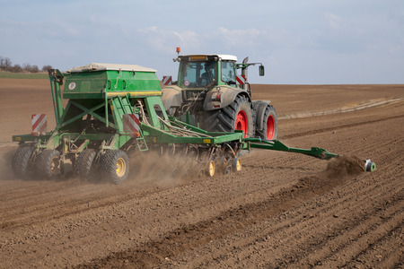seeding: Tractor with seeding machine Stock Photo