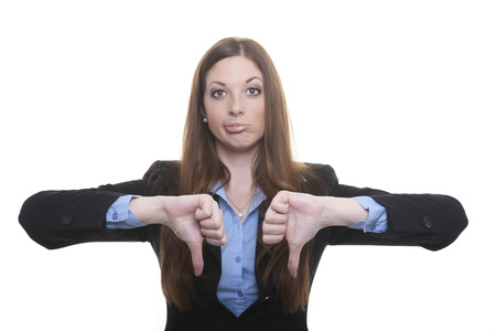 freisteller: Business woman with negative facial expression shows both thumbs down